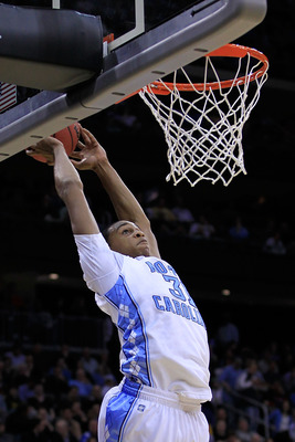 NEWARK, NJ - MARCH 25:  John Henson #31 of the North Carolina Tar Heels goes for a dunk against the Marquette Golden Eagles during the east regional semifinal of the 2011 NCAA Men's Basketball Tournament at the Prudential Center on March 25, 2011 in Newar
