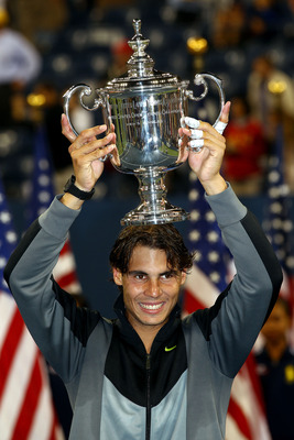 NEW YORK - SEPTEMBER 13:  Rafael Nadal of Spain celebrates with the championship trophy after defeating Novak Djokovic of Serbia to win the men's singles final on day fifteen of the 2010 U.S. Open at the USTA Billie Jean King National Tennis Center on Sep