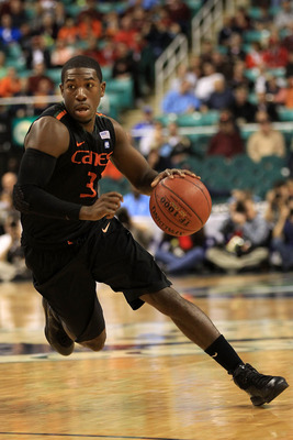 GREENSBORO, NC - MARCH 10:  Malcolm Grant #3 of the Miami Hurricanes drives against the Virginia Cavaliers during the second half of the game in the first round of the 2011 ACC men's basketball tournament at the Greensboro Coliseum on March 10, 2011 in Gr