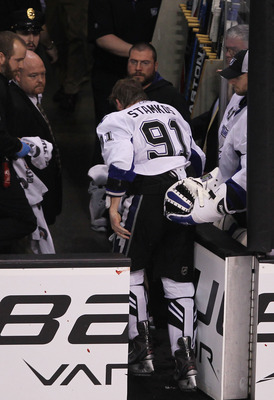 BOSTON, MA - MAY 27:  Steven Stamkos #91 of the Tampa Bay Lightning skates off the ice after being hit in the face with the puck in the second period of Game Seven of the Eastern Conference Finals against the Boston Bruins during the 2011 NHL Stanley Cup