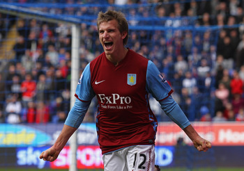BOLTON, ENGLAND - MARCH 05:  Marc Albrighton of Aston Villa celebrates after scoring his goal during the Barclays Premier League match between Bolton Wanderers and Aston Villa at the Reebok Stadium on March 5, 2011 in Bolton, England.  (Photo by Alex Live