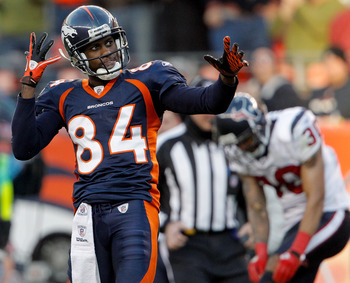 DENVER - DECEMBER 26:  Wide receiver Brandon Lloyd #84 of the Denver Broncos celebrates after a 41-yard reception against corner back Jason Allen #30 of the Houston Texans during the third quarter at INVESCO Field at Mile High on December 26, 2010 in Denv