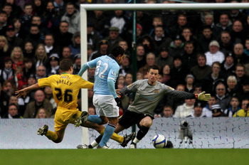 MANCHESTER, ENGLAND - FEBRUARY 20:  Carlos Tevez of Manchester City goes through on goal to score the third goal during the FA Cup sponsored by E.On 4th Round replay match between Manchester City and Notts County at City of Manchester Stadium on February