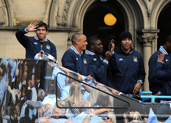 MANCHESTER, ENGLAND - MAY 23:  Carlos Tevez (L) of Manchester City waves to the crowd during the Manchester City FA Cup Winners Parade at Manchester Town Hall on May 23, 2011 in Manchester, United Kingdom.  (Photo by Chris Brunskill/Getty Images)