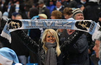 MANCHESTER, ENGLAND - DECEMBER 20:  A Manchester City supporter shows her support for Carlos Tevez during the Barclays Premier League match between Manchester City and Everton at City of Manchester Stadium on December 20, 2010 in Manchester, England.  (Ph