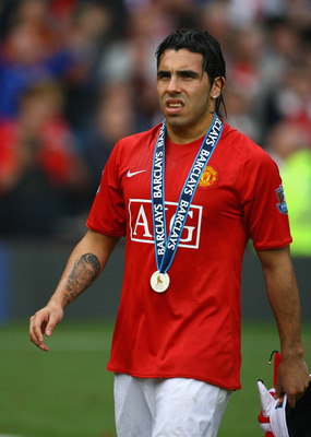 MANCHESTER, ENGLAND - MAY 16:  Carlos Tevez of Manchester United looks on after his side won the Premier League title at the end of the Barclays Premier League match between Manchester United and Arsenal at Old Trafford on May 16, 2009 in Manchester, Engl
