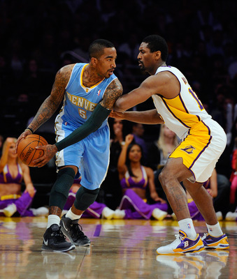 LOS ANGELES, CA - APRIL 03:  Ron Artest #15 of the Los Angeles Lakers defends against JR Smith #5 of the Denver Nuggets at Staples Center on April 3, 2011 in Los Angeles, California. NOTE TO USER: User expressly acknowledges and agrees that, by downloadin