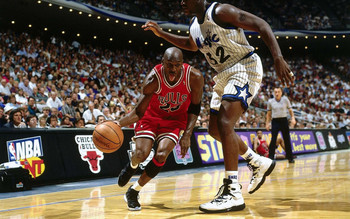 Michael Jordan dribble driving past Shaquille ONeal