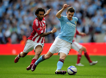LONDON, ENGLAND - MAY 14:  Adam Johnson of Manchester City competes with Jermaine Pennant of Stoke City during the FA Cup sponsored by E.ON Final match between Manchester City and Stoke City at Wembley Stadium on May 14, 2011 in London, England. (Photo by