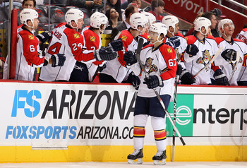GLENDALE, AZ - DECEMBER 04:  Michael Frolik #67 of the Florida Panthers celebrates with teammates on the bench after scoring a second period goal against the Phoenix Coyotes during the NHL game at Jobing.com Arena on December 4, 2010 in Glendale, Arizona.