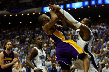 ORLANDO, FL - JUNE 09:  Kobe Bryant #24 of the Los Angeles Lakers goes up for a shot against Dwight Howard #12 of the Orlando Magic as Howard was called for a foul in Game Three of the 2009 NBA Finals on June 9, 2009 at Amway Arena in Orlando, Florida.  N