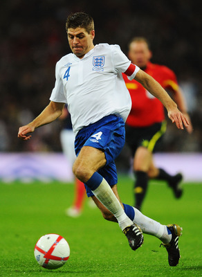 LONDON, ENGLAND - NOVEMBER 17:  Steven Gerrard of England runs with the ball during the international friendly match between England and France at Wembley Stadium on November 17, 2010 in London, England.  (Photo by Mike Hewitt/Getty Images)