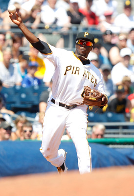 PITTSBURGH, PA - JULY 10:  Josh Harrison #62 of the Pittsburgh Pirates throws to first base against the Chicago Cubs during the game on July 10, 2011 at PNC Park in Pittsburgh, Pennsylvania.  (Photo by Jared Wickerham/Getty Images)
