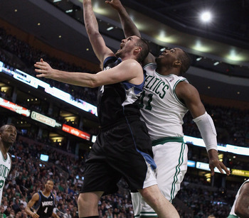 BOSTON, MA - JANUARY 03:  Kevin Love #42 of the Minnesota Timberwolves takes a shot as Glen Davis #11 of the Boston Celtics defends on January 3, 2011 at the TD Garden in Boston, Massachusetts. NOTE TO USER: User expressly acknowledges and agrees that, by