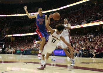 CLEVELAND - JUNE 02:  Tayshaun Prince #22 of the Detroit Pistons loses the ball as he drive to the basket against Anderson Varejao #17 and Sasha Pavlovic #3 of the Cleveland Cavaliers in Game Six of the Eastern Conference Finals during the 2007 NBA Playof