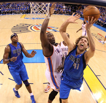OKLAHOMA CITY, OK - MAY 23:  Dirk Nowitzki #41 of the Dallas Mavericks goes up for a shot against Kendrick Perkins #5 of the Oklahoma City Thunder in the first half in Game Four of the Western Conference Finals during the 2011 NBA Playoffs at Oklahoma Cit