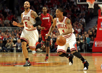 CHICAGO, IL - MAY 26:  Derrick Rose #1 of the Chicago Bulls brings the ball up court against the Miami Heat in Game Five of the Eastern Conference Finals during the 2011 NBA Playoffs on May 26, 2011 at the United Center in Chicago, Illinois. NOTE TO USER: