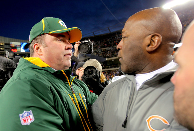 CHICAGO, IL - JANUARY 23:  Head coach Mike McCarthy of the Green Bay Packers and head coach Lovie Smith of the Chicago Bears shake hands after the Packers 21-14 victory in the NFC Championship Game at Soldier Field on January 23, 2011 in Chicago, Illinois