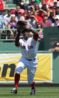 BOSTON, MA - JUNE 5: Mike Cameron #23 of the Boston Red Sox catches the ball against the Oakland Athletics at Fenway Park on June 5, 2011 in Boston, Massachusetts.  (Photo by Jim Rogash/Getty Images)