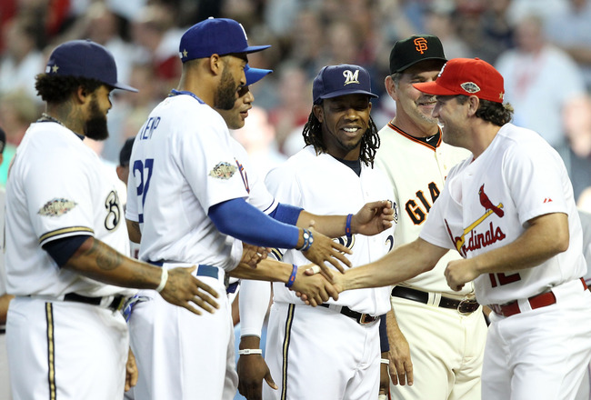 PHOENIX, AZ - JULY 12:  National League All-Star Lance Berkman #12 of the St. Louis Cardinals shakes hands with National League teammates before the start of the 82nd MLB All-Star Game at Chase Field on July 12, 2011 in Phoenix, Arizona.  (Photo by Christ
