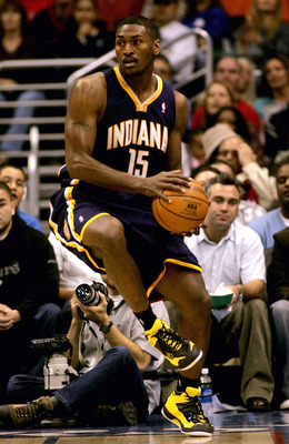 LOS ANGELES - NOVEMBER 27:   Ron Artest #15 of the Indiana Pacers controls a loose ball against the Los Angeles Clippers on November 27, 2005 at Staples Center in Los Angeles, California. The Pacers won 97-92. NOTE TO USER: User expressly acknowledges and