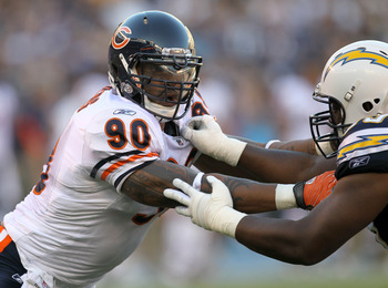 SAN DIEGO - AUGUST 14:  Defensive end Julius Peppers #90 of the Chicago Bears battles offensive guard Tyronne Green #69 of the San Diego Chargers on August 14, 2010 at Qualcomm Stadium in San Diego, California.  (Photo by Stephen Dunn/Getty Images)