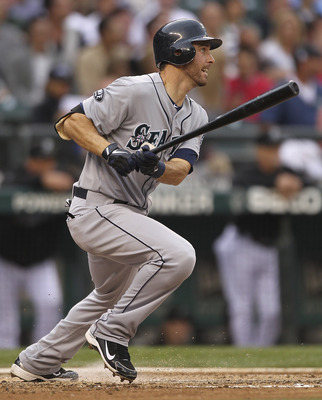 SEATTLE - JUNE 26:  Dustin Ackley #13 of the Seattle Mariners triples against the Florida Marlins at Safeco Field on June 26, 2011 in Seattle, Washington. (Photo by Otto Greule Jr/Getty Images)