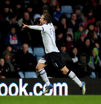 BIRMINGHAM, ENGLAND - DECEMBER 26:  Rafael Van Der Vaart (L) of Tottenham celebrates as he scores the second goal during the Barclays Premier League match between Aston Villa and Tottenham Hotspur at Villa Park on December 26, 2010 in Birmingham, England.