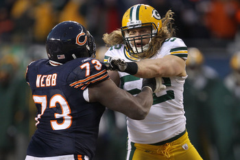 CHICAGO, IL - JANUARY 23:  Linebacker Clay Matthews #52 of the Green Bay Packers is blocked by J'Marcus Webb #73 of the Chicago Bears in the NFC Championship Game at Soldier Field on January 23, 2011 in Chicago, Illinois.  (Photo by Jonathan Daniel/Getty