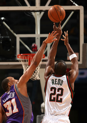 MILWAUKEE - JANUARY 22:  Michael Redd #22 of the Milwaukee Bucks attempts a shot against Shawn Marion #31 of the Phoenix Suns at the Bradley Center on January 22, 2008 in Milwaukee, Wisconsin.  NOTE TO USER: User expressly acknowledges and agrees that, by