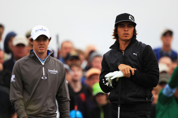 SANDWICH, ENGLAND - JULY 14:  Rickie Fowler (R) of the United States waits with Rory McIlroy of Northern Ireland on the 4th hole during the first round of The 140th Open Championship at Royal St George's on July 14, 2011 in Sandwich, England.  (Photo by S