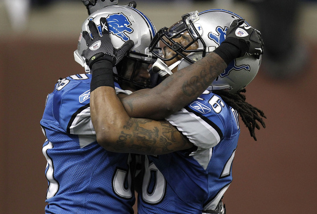 DETROIT, MI - DECEMBER 12:  Louis Delmas #26 of the Detroit Lions celebrates with Nathan Vasher #30 after a fourth down incomplete pass by the Green Bay Packers on December 12, 2010 at Ford Field in Detroit, Michigan. Detroit won the game 7-3  (Photo by G
