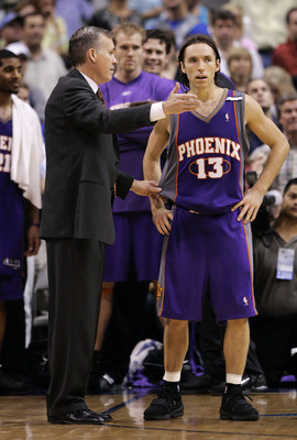 DALLAS, TX - MAY 20: Head coach Mike D'Antoni talks with Steve Nash #13 of the Phoenix Suns in overtime against the Dallas Mavericks in Game six of the Western Conference Semi-finals during the 2005 NBA Playoffs at the American Airlines Center on May 20,