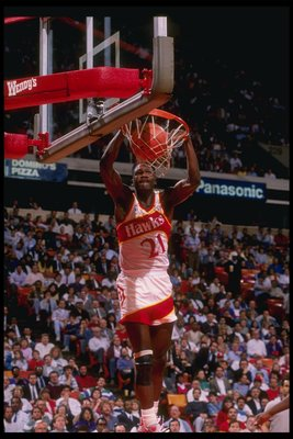 Forward Dominique Wilkins of the Atlanta Hawks slam dunks the ball during a game at the Omni in Atlanta, Georgia.