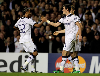 LONDON, ENGLAND - NOVEMBER 02:  Gareth Bale (R)  of Spurs is congratulated by teammate Benoit Assou-Ekotto (L) after setting up hius team's third goal during the UEFA Champions League Group A match between Tottenham Hotspur and Inter Milan at White Hart L