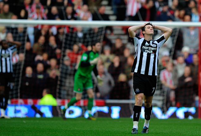 SUNDERLAND, ENGLAND - JANUARY 16: A dejected Joey Barton of  Newcastle during the Barclays Premier League match between Sunderland and Newcastle United at Stadium of Light on January 16, 2011 in Sunderland, England.  (Photo by Stu Forster/Getty Images)
