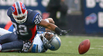 ORCHARD PARK, NY - NOVEMBER 14: Fred Jackson #22 of the Buffalo Bills fumbles while being tackled by Lawrence Jackson #94 of the Detroit Lions at Ralph Wilson Stadium on November 14, 2010 in Orchard Park, New York.  (Photo by Rick Stewart/Getty Images)