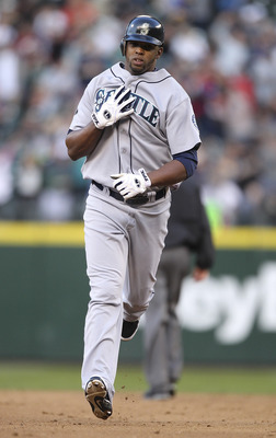 SEATTLE - JUNE 25:  Carlos Peguero #8 of the Seattle Mariners runs the bases after hitting a home run against the Florida Marlins at Safeco Field on June 25, 2011 in Seattle, Washington. (Photo by Otto Greule Jr/Getty Images)
