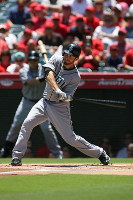 ANAHEIM, CA - JULY 10:  Dustin Ackley #13 of the Seattle Mariners bats against the Los Angeles Angels of Anaheim at Angel Stadium of Anaheim on July 10, 2011 in Anaheim, California.  (Photo by Jeff Golden/Getty Images)