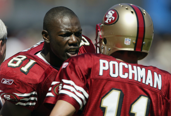 SAN FRANCISCO - SEPTEMBER 21:  Wide receiver Terrell Owens #81 of the San Francisco 49ers talks to his kicker Owen Pochman #11 during the game against the Cleveland Browns at Candlestick Park on September 21, 2003 in San Francisco, California. The Browns