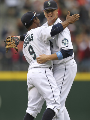 SEATTLE - JUNE 19:  Justin Smoak #17 of the Seattle Mariners (R) is congratulated by Chone Figgins #9 after the Mariners defeated the Philadelphia Phillies 2-0 at Safeco Field on June 19, 2011 in Seattle, Washington. (Photo by Otto Greule Jr/Getty Images)