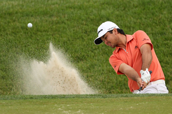 BETHESDA, MD - JUNE 19:  Jason Day of Australia plays a bunker shot on the 18th hole during the final round of the 111th U.S. Open at Congressional Country Club on June 19, 2011 in Bethesda, Maryland.  (Photo by Andrew Redington/Getty Images)