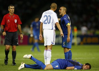 BERLIN - JULY 09: David Trezeguet (L) of France and Fabio Cannavaro (R) of Italy argue, whilst Marco Materazzi of Italy lies injured, after being headbutted  in the chest by Zinedine Zidane of France during the FIFA World Cup Germany 2006 Final match betw