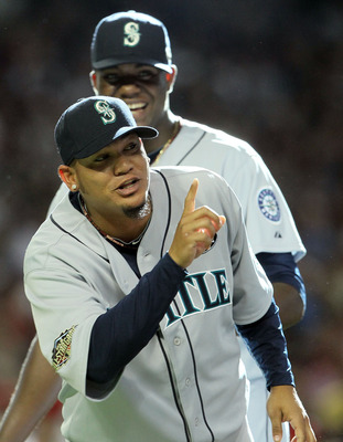 PHOENIX, AZ - JULY 12:  American League All-Star Felix Hernandez #34 of the Seattle Mariners points as he stands in front of teammate Michael Pineda #36 before the start of the 82nd MLB All-Star Game at Chase Field on July 12, 2011 in Phoenix, Arizona.  (