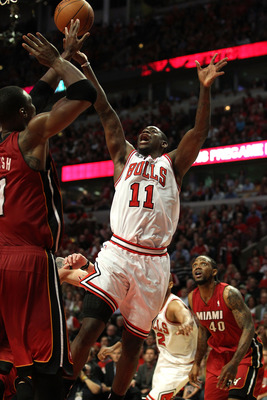 CHICAGO, IL - MAY 26:  Ronnie Brewer #11 of the Chicago Bulls attempts a shot agaisnt the Miami Heat in Game Five of the Eastern Conference Finals during the 2011 NBA Playoffs on May 26, 2011 at the United Center in Chicago, Illinois. NOTE TO USER: User e