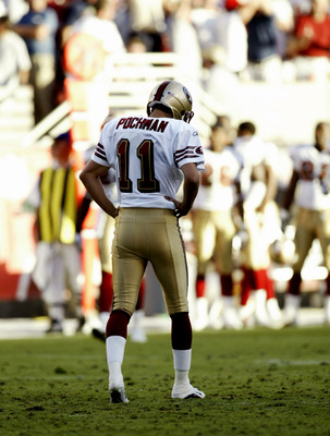 TEMPE, AZ  - OCTOBER 26:  Kicker Owen Pochman #11 of the San Francisco 49ers walks off the field after he missed on a field goal attempt to take the lead late in the fourth quarter against the Arizona Cardinals October 26, 2003 at Sun Devil Stadium in Tem