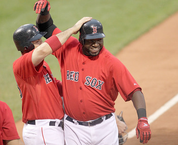 BOSTON, MA - JULY 8:  David Ortiz #34 of the Boston Red Sox celebrates with teammate Adrian Gonzalez #28 of the Boston Red Sox after hitting a three-run home run off of Zach Britton #53 of the Baltimore Orioles in the first inning at Fenway Park on July 8