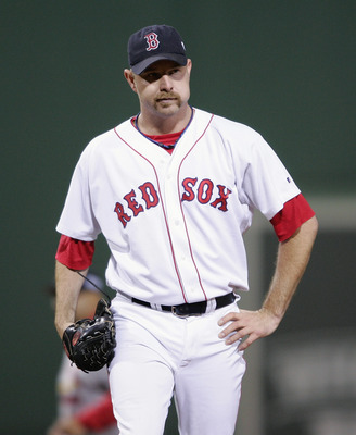 BOSTON - OCTOBER 23:  Alan Embree #43 of the Boston Red Sox stands on the field against the St. Louis Cardinals during game one of the 2004 World Series on October 23, 2004 at Fenway Park in Boston, Massachusetts. (Photo by Elsa/Getty Images)
