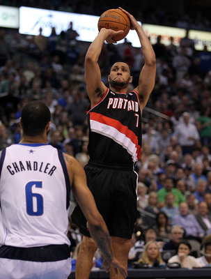 DALLAS, TX - APRIL 25:  Guard Brandon Roy #7 of the Portland Trail Blazers takes a shot against Tyson Chandler #6 of the Dallas Mavericks in Game Five of the Western Conference Quarterfinals during the 2011 NBA Playoffs on April 25, 2011 at American Airli