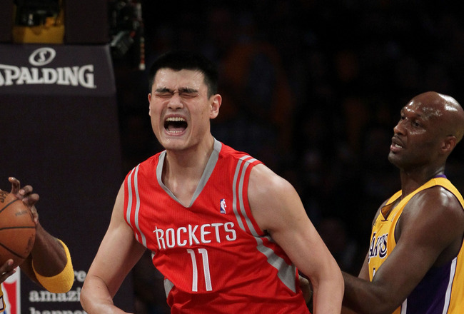 LOS ANGELES, CA - OCTOBER 26:  Yao Ming #11 of the Houston Rockets reacts to a play during their opening night game against the Los Angeles Lakers at Staples Center on October 26, 2010 in Los Angeles, California. NOTE TO USER: User expressly acknowledges